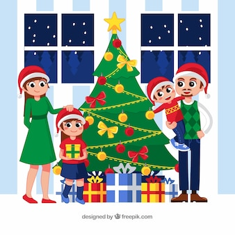飾られたクリスマスツリーの横にある大きな家族