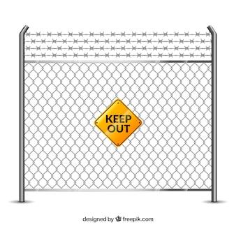 黄色のサインと有刺鉄線と金属フェンス
