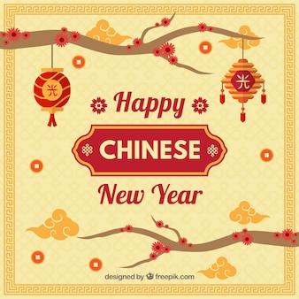 枝を持つ中国の新年の背景