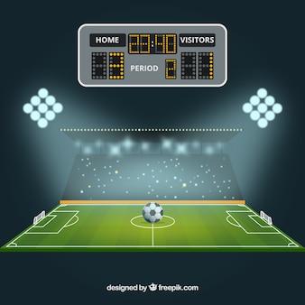 スコアボード付きサッカーフィールドの背景