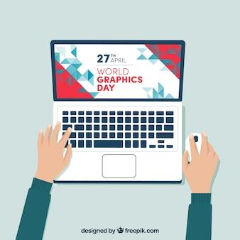 ノートパソコンを搭載した世界のグラフィックデイの背景