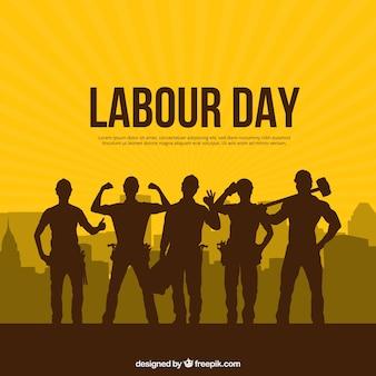 労働者の日の背景シルエットの人々