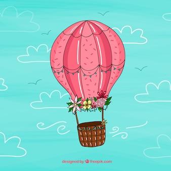空の風船の背景に手を描いた風