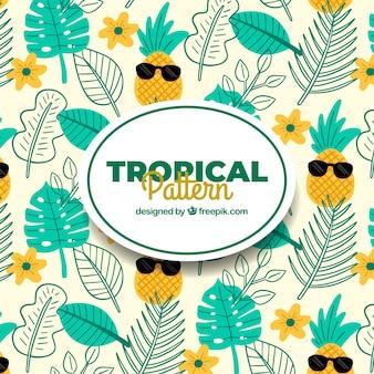 植物とパイナップルの熱帯夏の模様