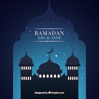 夜のモスクのシルエットとラマダンの背景