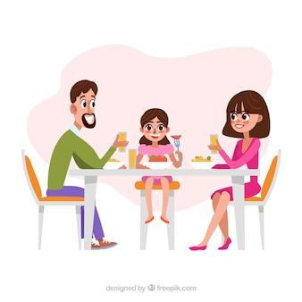 夕食を一緒に持つ幸せな家族