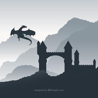 ドラゴン飛行と城のシルエットの背景