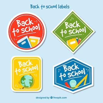 Коллекция обратно в школьные значки в четырех цветах