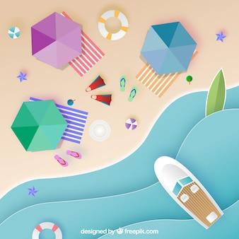 Вид на пляж с оригами