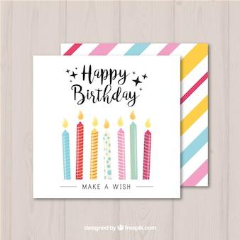 カラフルなキャンドルと誕生日カード