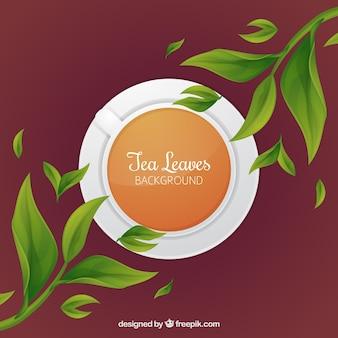 平らなデザインの茶葉の背景
