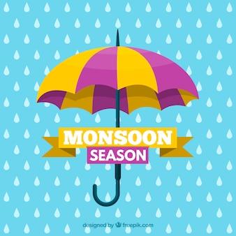 雨と傘のあるモンスーン季節の背景