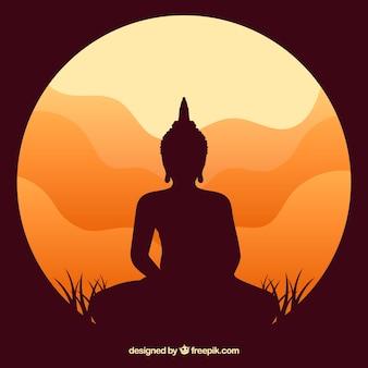 Статуя силуэт будды с закатом