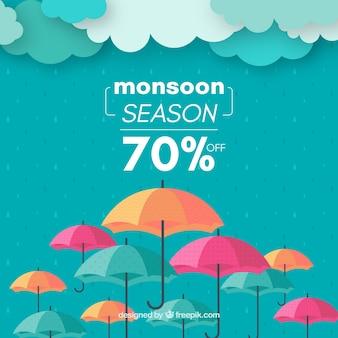 モンスーンの季節の販売の背景と傘