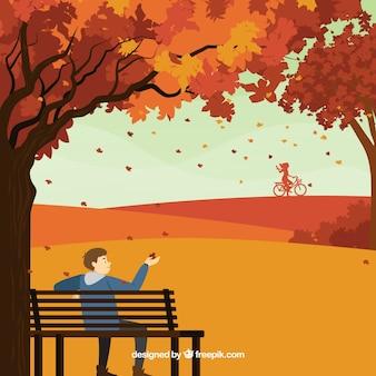 公園にいる人と秋の背景