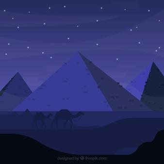 エジプトピラミッドの背景ラクダのキャラバンと夜の風景