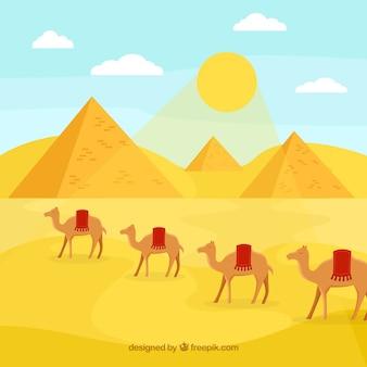 ピラミッドとキャラバンの砂漠の風景