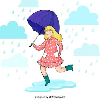 傘を持つ女の子の幸せなモンスーンの背景