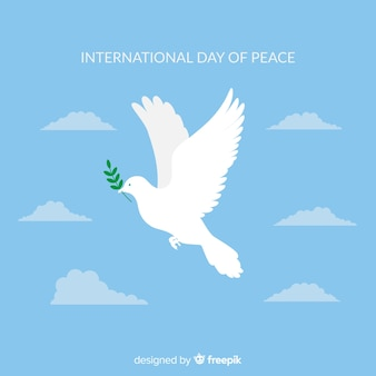 平らな白い鳩と平和の日の構成