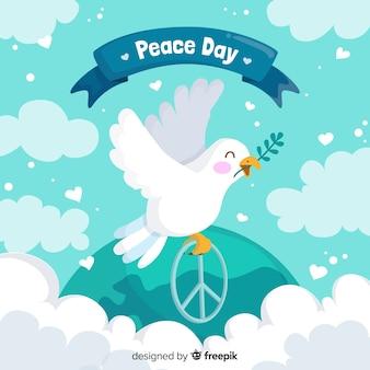 白い鳩と手描きの国際平和の日の概念