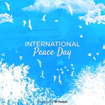 白い鳩と水彩画の国際平和の日のコンセプト