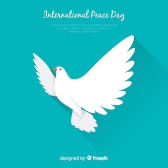 白い鳩と国際平和の日のコンセプト