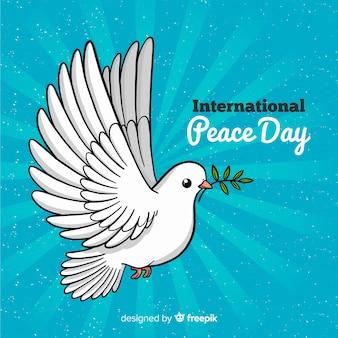 手で描かれた鳩と平和の日の背景