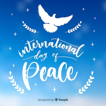 白い鳩とエレガントな平和の日の背景