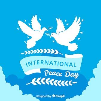 平らな白い鳩と平和の構成の日