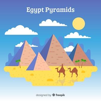 ピラミッドとラクダのエジプトの風景の背景