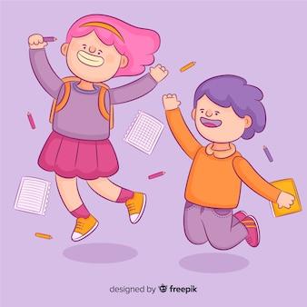 Счастливые школьники прыгают