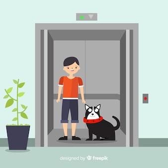 エレベーターで犬を持つ女性
