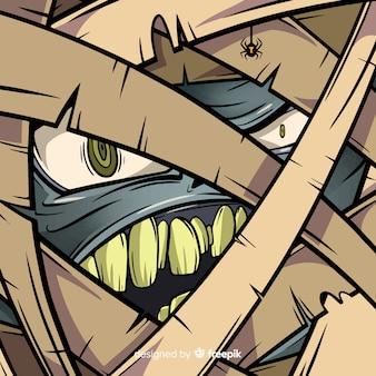 ハッピーハロウィンの背景と邪悪なミイラの顔