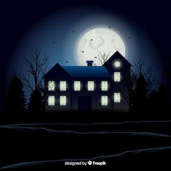 ハロウィーンの幽霊のある家の背景とグラデーションライト
