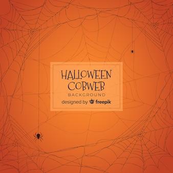 手でハロウィーンの背景を描いたクモの巣