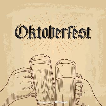 ビールの瓶と手で描かれたオクトーバーフェストの背景