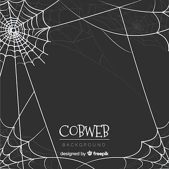手で描かれたハロウィンのコブウェブの背景