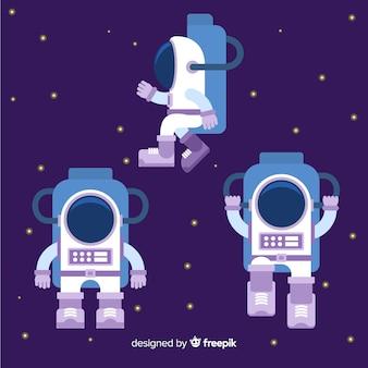 フラットデザインのカラフルな宇宙飛行士の構成