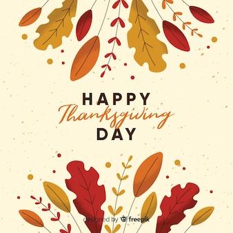 秋の要素を持つフラットデザインでの感謝祭の日の背景
