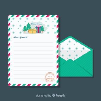 平らなクリスマスの封筒と手紙の概念