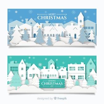 紙のスタイルで美しいクリスマスタウンのバナー
