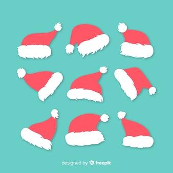 Рождественская коллекция шляпы санта-клауса в плоском дизайне