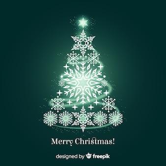 輝く雪片クリスマスツリーの背景