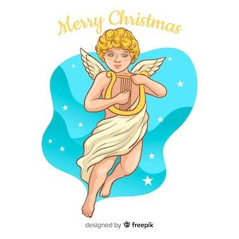 フラットデザインの素敵なクリスマス天使の背景