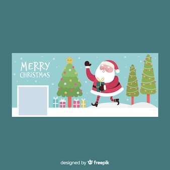 クリスマスのフェイスブックカバーを振るサンタ