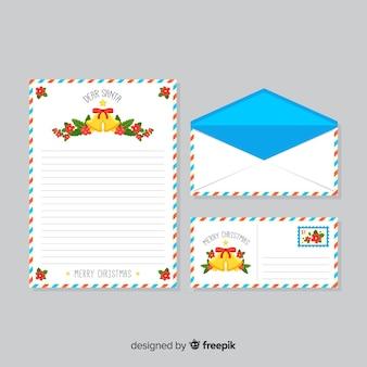 鐘を持つ封筒とクリスマスの手紙