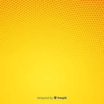 黄色の抽象的なハーフトーンの背景