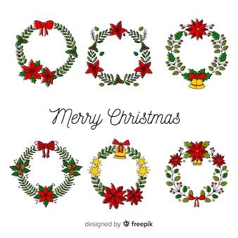 美しい手描きのクリスマスの花と花輪のコレクション