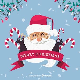 手描きのサンタ顔クリスマスの背景