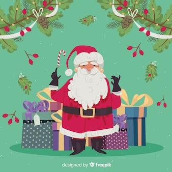 手描きのサンタクロースはクリスマスの背景をプレゼント
